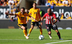 WOLVERHAMPTON, ENGLAND - SEPTEMBER 29: Nathan Redmond(R) of Southampton gets away from Joao Mouthino during the Premier League match between Wolverhampton Wanderers and Southampton FC at Molineux on September 29, 2018 in Wolverhampton, United Kingdom. (Photo by Matt Watson/Southampton FC via Getty Images)