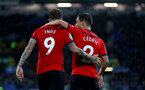 LIVERPOOL, ENGLAND - OCTOBER 02: Danny Ings of Southampton celebrates with Cedric after putting his team 1-0 up during the Carabao Cup Third Round match between Everton and Southampton at Goodison Park on October 2nd, 2018 in Liverpool, England. (Photo by Matt Watson/Southampton FC via Getty Images)
