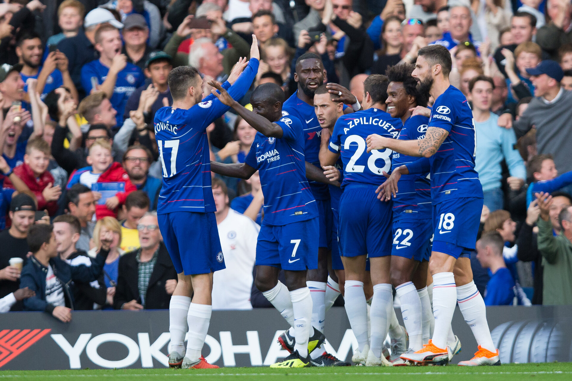LONDON, ENGLAND - SEPTEMBER 29: Eden Hazard of Chelsea celebrates scoring the opening goal with team-mates during the Premier League match between Chelsea FC and Liverpool FC at Stamford Bridge on September 29, 2018 in London, United Kingdom. (Photo by Craig Mercer/MB Media/Getty Images)