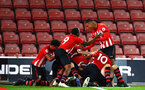 SOUTHAMPTON, ENGLAND - OCTOBER 19: Southampton FC  players celebrate after a last minute goal by Thomas O'Connor during the PL2 match between Southampton FC and Wolves pictured at St Mary's Stadium on October 19, 2018 in Southampton, England. (Photo by James Bridle - Southampton FC/Southampton FC via Getty Images)