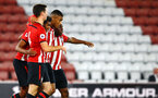 SOUTHAMPTON, ENGLAND - OCTOBER 19: Macrus Barnes scores for Southampton FC celebrating with Thomas O'Connor, Yan Valery, Michael Obafemi during the PL2 match between Southampton FC and Wolves pictured at St Mary's Stadium on October 19, 2018 in Southampton, England. (Photo by James Bridle - Southampton FC/Southampton FC via Getty Images)