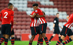 SOUTHAMPTON, ENGLAND - OCTOBER 19: Marcus Barnes hugs Michael Obafemi after he's scores during the PL2 match between Southampton FC and Wolves pictured at St Mary's Stadium on October 19, 2018 in Southampton, England. (Photo by James Bridle - Southampton FC/Southampton FC via Getty Images)