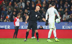 LEICESTER, ENGLAND - NOVEMBER 27: Referee Roger East indictes a free kick as Southampton's goal is disallowed via VAR during the Carabao Cup Fourth Round match between Leicester City and Southampton at The King Power Stadium on November 27th, 2018 in Leicester, England. (Photo by Matt Watson/Southampton FC via Getty Images)