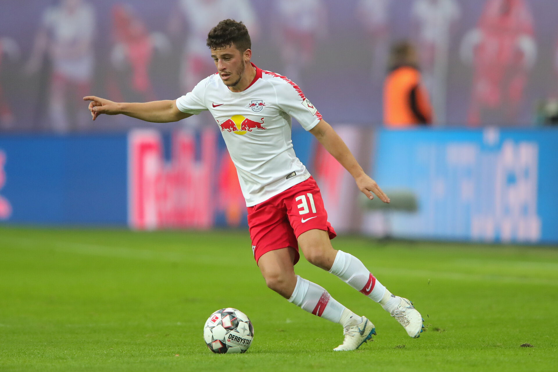 LEIPZIG, GERMANY - NOVEMBER 11:  Diego Demme of Leipzig runs with the ball during the Bundesliga match between RB Leipzig and Bayer 04 Leverkusen at Red Bull Arena on November 11, 2018 in Leipzig, Germany.  (Photo by Alexander Hassenstein/Bongarts/Getty Images)