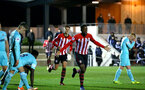 SOUTHAMPTON, ENGLAND - DECEMBER 14: Jonathan Afolabi scores (middle) during the U23s Cup match between Southampton FC and Newcastle United pictured at Staplewood Training Ground on December 14, 2018 in Southampton England. (Photo by James Bridle - Southampton FC/Southampton FC via Getty Images)