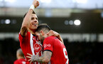 SOUTHAMPTON, ENGLAND - DECEMBER 16: Danny Ings(R) of Southampton celebrates with Jan Bednarek(L) after scoring his second during the Premier League match between Southampton FC and Arsenal FC at St Mary's Stadium on December 15, 2018 in Southampton, United Kingdom. (Photo by Matt Watson/Southampton FC via Getty Images)