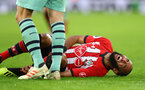 SOUTHAMPTON, ENGLAND - DECEMBER 16: Nathan Redmond of Southampton down injured during the Premier League match between Southampton FC and Arsenal FC at St Mary's Stadium on December 15, 2018 in Southampton, United Kingdom. (Photo by Matt Watson/Southampton FC via Getty Images)