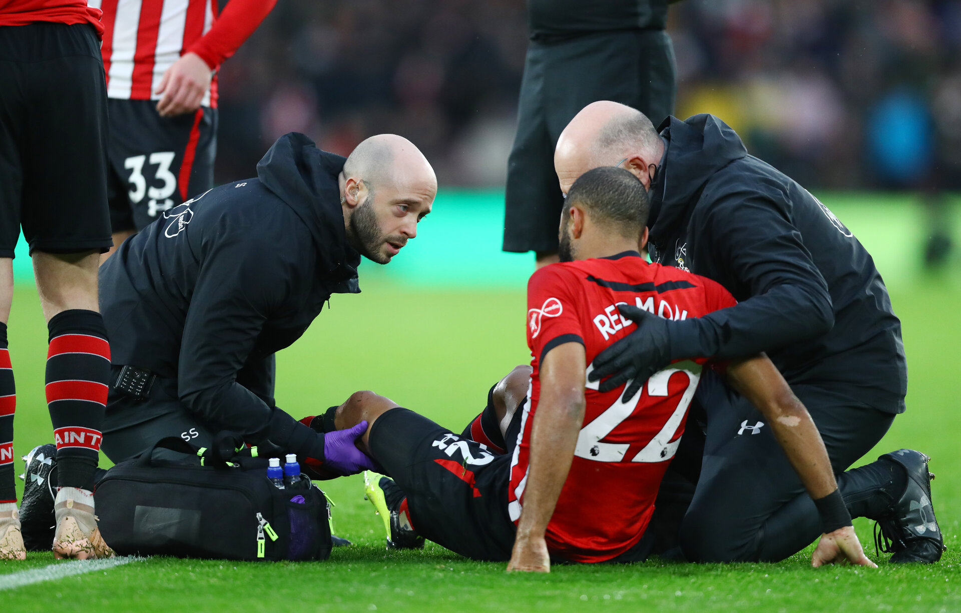 SOUTHAMPTON, ENGLAND - DECEMBER 16: Nathan Redmond of Southampton receives treatment form Steve Sparks during the Premier League match between Southampton FC and Arsenal FC at St Mary's Stadium on December 15, 2018 in Southampton, United Kingdom. (Photo by Matt Watson/Southampton FC via Getty Images)