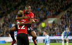 HUDDERSFIELD, ENGLAND - DECEMBER 22:  Michael Obafemi(R) of Southampton celebrates with Nathan Redmond(L) during the Premier League match between Huddersfield Town and Southampton FC at John Smith's Stadium on December 22, 2018 in Huddersfield, United Kingdom. (Photo by Matt Watson/Southampton FC via Getty Images)