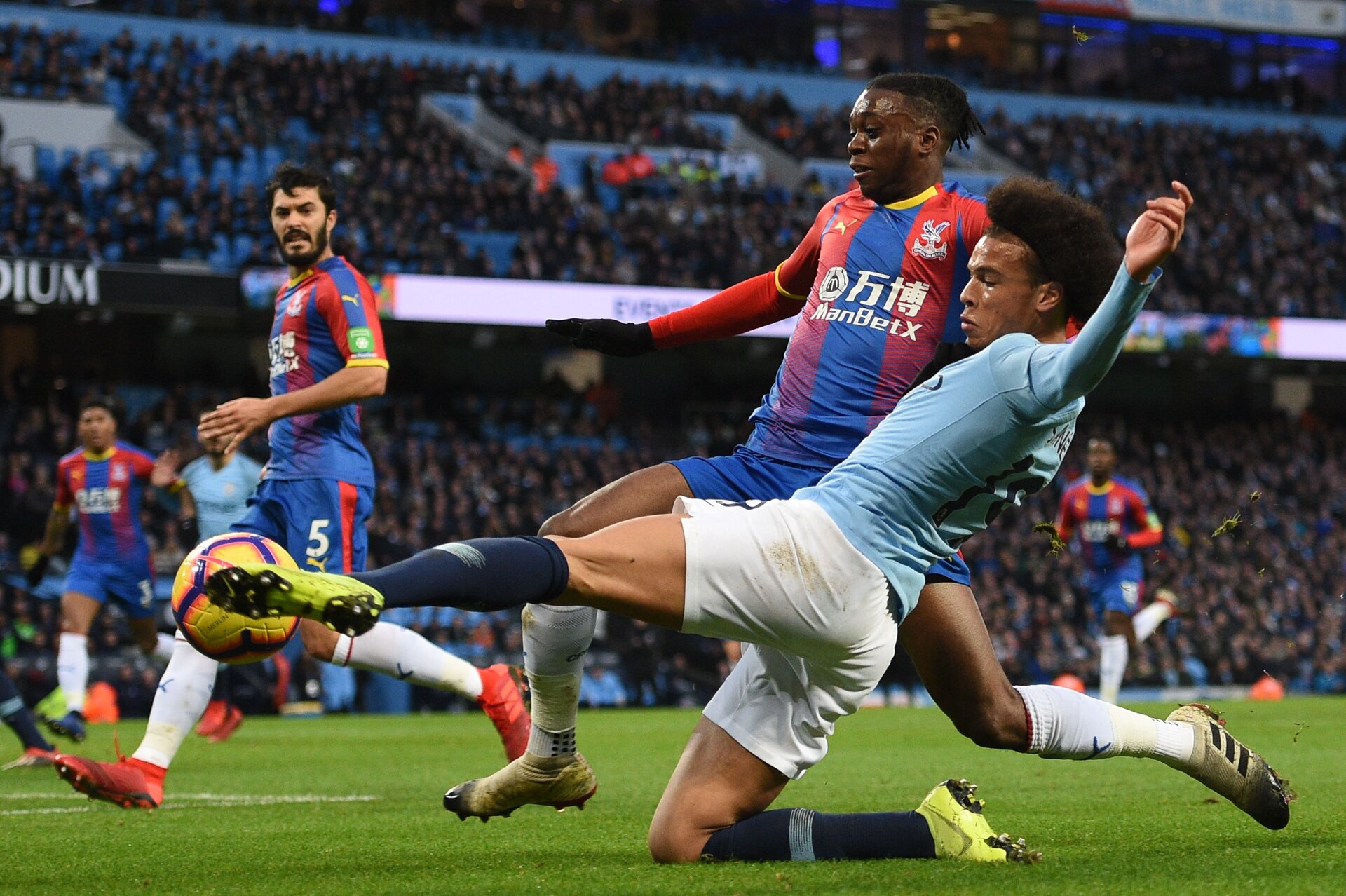 Manchester City's German midfielder Leroy Sane (R) vies with Crystal Palace's English midfielder Aaron Wan-Bissaka (L) during the English Premier League football match between Manchester City and Crystal Palace at the Etihad Stadium in Manchester, north west England, on December 22, 2018. (Photo by Oli SCARFF / AFP) / RESTRICTED TO EDITORIAL USE. No use with unauthorized audio, video, data, fixture lists, club/league logos or 'live' services. Online in-match use limited to 120 images. An additional 40 images may be used in extra time. No video emulation. Social media in-match use limited to 120 images. An additional 40 images may be used in extra time. No use in betting publications, games or single club/league/player publications. /         (Photo credit should read OLI SCARFF/AFP/Getty Images)