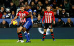 LEICESTER, ENGLAND - JANUARY 12: Shane Long(L) of Southampton and Wes Morgan of Leicester City during the Premier League match between Leicester City and Southampton FC at The King Power Stadium on January 12, 2019 in Leicester, United Kingdom. (Photo by Matt Watson/Southampton FC via Getty Images)