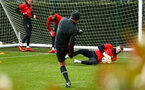 SOUTHAMPTON, ENGLAND - JANUARY 15: Dave Watson, tests Fraser Forster as he saves the ball (right) during a Southampton FC  training session at Staplewood Complex on January 15, 2019 in Southampton, England. (Photo by James Bridle - Southampton FC/Southampton FC via Getty Images)