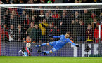 SOUTHAMPTON, ENGLAND - JANUARY 16: Angus Gunn of Southampton is beaten from the penalty spot during the FA Cup Third Round Replay match between Southampton FC and Derby County at St Mary's Stadium on January 16, 2019 in Southampton, United Kingdom. (Photo by Matt Watson/Southampton FC via Getty Images)