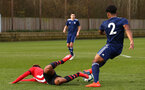 SOUTHAMPTON, ENGLAND - JANUARY 26: Enzo Robise is taken down (left) during the Under 18s match between Southampton FC and Fulham FC pictured at Staplewood Complex on January 26, 2019 in Southampton, England. (Photo by James Bridle - Southampton FC/Southampton FC via Getty Images)