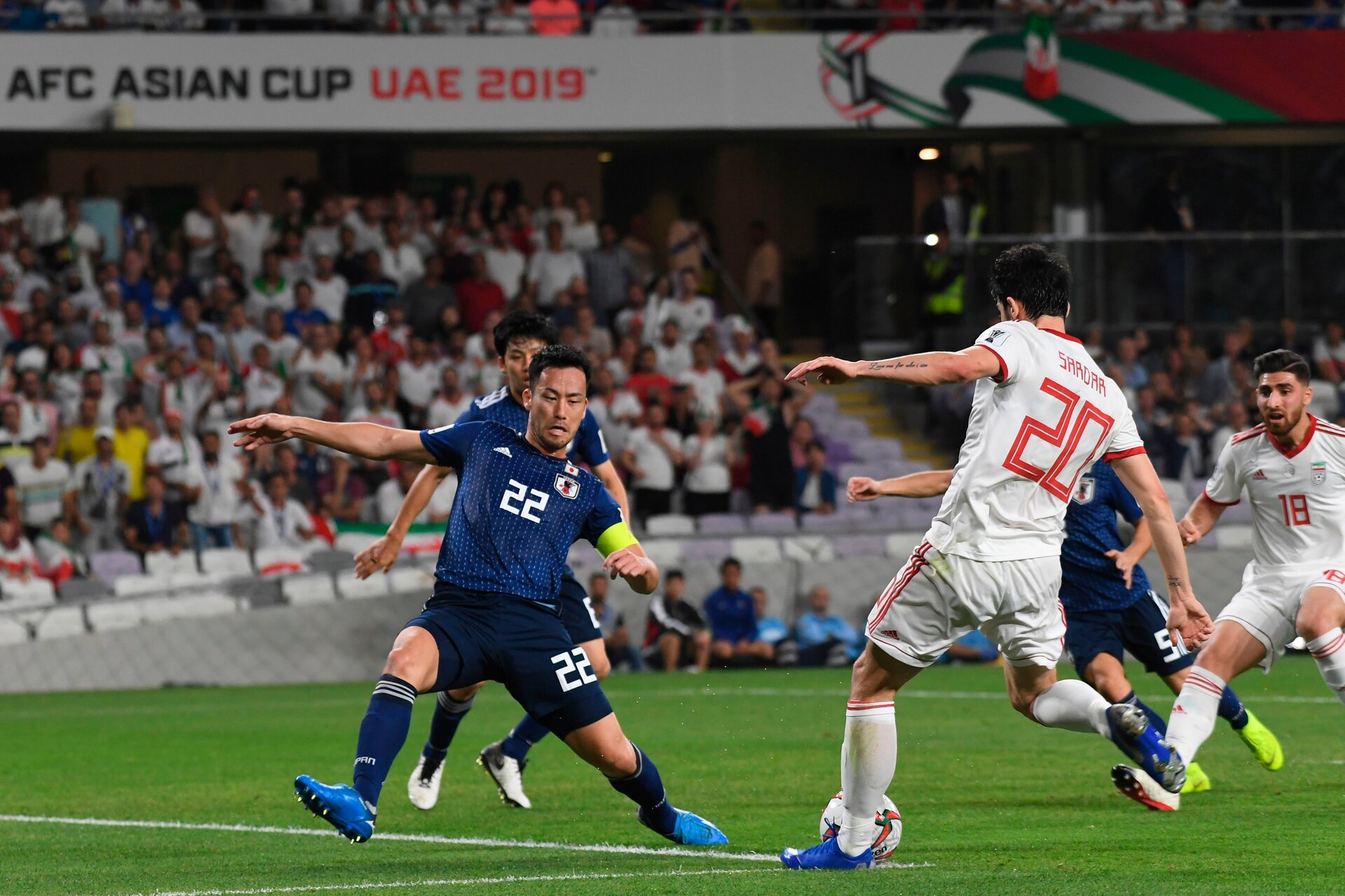 Iran's forward Sardar Azmoun (2nd-R) attempts a shot as he is closed down by Japan's defender Maya Yoshida (L) during the 2019 AFC Asian Cup semi-final football match between Iran and Japan at the Hazza Bin Zayed Stadium in Abu Dhabi on January 28, 2019. (Photo by Roslan RAHMAN / AFP)        (Photo credit should read ROSLAN RAHMAN/AFP/Getty Images)
