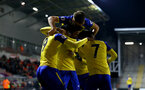 LEIGH, GREATER MANCHESTER - FEBRUARY 01:  Jonathan Afolabi (left) scores for Southampton FC and celebrates with Harry Hamblin, Oludare Olufunwa, Nathan Tella during the PL2 match between Manchester United and Southampton FC pictured at Leigh Sports Village on February 01, 2019 in Leigh, Greater Manchester. (Photo by James Bridle - Southampton FC/Southampton FC via Getty Images)