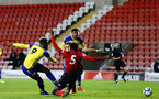 LEIGH, GREATER MANCHESTER - FEBRUARY 01:  Jonathan Afolabi scores (left) for Southampton FC, working his way round Manchester United's Di'shon Bernard (middle) during the PL2 match between Manchester United and Southampton FC pictured at Leigh Sports Village on February 01, 2019 in Leigh, Greater Manchester. (Photo by James Bridle - Southampton FC/Southampton FC via Getty Images)