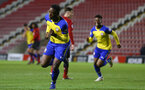 LEIGH, GREATER MANCHESTER - FEBRUARY 01:  Jonathan Afolabi Scores and celebrates during the PL2 match between Manchester United and Southampton FC pictured at Leigh Sports Village on February 01, 2019 in Leigh, Greater Manchester. (Photo by James Bridle - Southampton FC/Southampton FC via Getty Images)