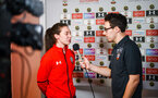 SOUTHAMPTON, ENGLAND - FEBRUARY 14: Tom Deacon (right) speaks with Harriet Eastham SFC Womens player (left) during the ePremier League tournament held at St Mary's Stadium on February 14, 2019 in Southampton, England. (Photo by James Bridle - Southampton FC/Southampton FC via Getty Images)