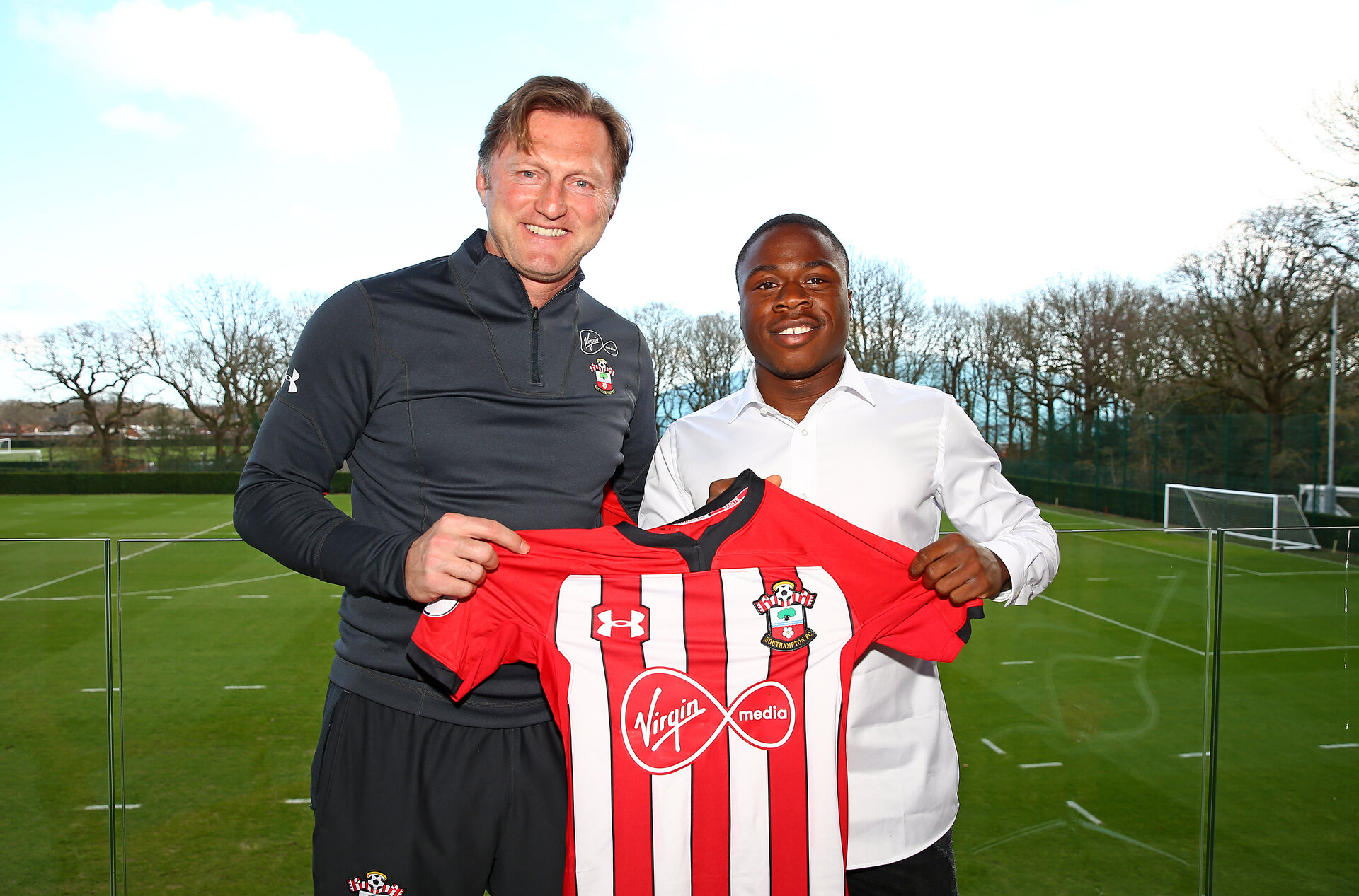 SOUTHAMPTON, ENGLAND - FEBRUARY 20: Michael Obafemi signs a new three and a half year contract with Southampton FC, pictured with manager Ralph Hasenhuttl(L) at the Staplewood Campus, on February 20, 2019 in Southampton, England. (Photo by Matt Watson/Southampton FC via Getty Images)