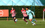 SOUTHAMPTON, ENGLAND - FEBRUARY 23: Ethan Burnett (middle) during the U18's premier league match between Southampton FC and Arsenal FC pictured in Southampton, England. (Photo by James Bridle - Southampton FC/Southampton FC via Getty Images)