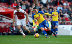 LONDON, ENGLAND - FEBRUARY 24: Sokratis Papastathopoulos(L) of Arsenal and Mohamed Elyounoussi of Southampton during the Premier League match between Arsenal FC and Southampton FC at Emirates Stadium on February 24, 2019 in London, United Kingdom. (Photo by Matt Watson/Southampton FC via Getty Images)
