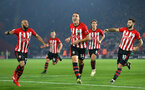 SOUTHAMPTON, ENGLAND - FEBRUARY 27:  Oriol Romeu (middle) scores for Southampton and celebrates with Nathan Redmond (left) Charlie Austin (right) during the Premier League match between Southampton FC and Fulham FC at St Mary's Stadium on February 27, 2019 in Southampton, United Kingdom. (Photo by James Bridle - Southampton FC/Southampton FC via Getty Images)