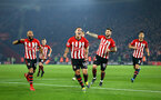 SOUTHAMPTON, ENGLAND - FEBRUARY 27:  Oriol Romeu of Southampton FCscores and celebrates (middle) with Nathan Redmond, Charlie Austin, Maya Yoshida during the Premier League match between Southampton FC and Fulham FC at St Mary's Stadium on February 27, 2019 in Southampton, United Kingdom. (Photo by James Bridle - Southampton FC/Southampton FC via Getty Images)