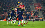 SOUTHAMPTON, ENGLAND - FEBRUARY 27:  Jannik Vestergaard challenges for the header (middle) during the Premier League match between Southampton FC and Fulham FC at St Mary's Stadium on February 27, 2019 in Southampton, United Kingdom. (Photo by James Bridle - Southampton FC/Southampton FC via Getty Images)