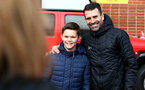 SOUTHAMPTON, ENGLAND - MARCH 09: Ex Southampton FC player Francis Benali (right) with young fan (left) ahead of §the Premier League match between Southampton FC and Tottenham Hotspur at St Mary's Stadium on March 09, 2019 in Southampton, United Kingdom. (Photo by James Bridle - Southampton FC/Southampton FC via Getty Images)