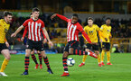 WOLVERHAMPTON, ENGLAND - MARCH 05:  Kayne Ramsay  shoots (middle) during the PL2 U23's match between Wolverhampton Wanders and Southampton FC at Molineux Stadium in Wolverhampton, England, on March 05, 2019 (Photo by James Bridle - Southampton FC/Southampton FC via Getty Images)