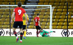 WOLVERHAMPTON, ENGLAND - MARCH 05:  Harry Lewis makes a save (right) during the PL2 U23's match between Wolverhampton Wanders and Southampton FC at Molineux Stadium in Wolverhampton, England, on March 05, 2019 (Photo by James Bridle - Southampton FC/Southampton FC via Getty Images)