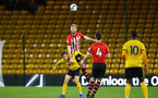 WOLVERHAMPTON, ENGLAND - MARCH 05:  Aaron O'Driscoll  heads the ball away (middle) during the PL2 U23's match between Wolverhampton Wanders and Southampton FC at Molineux Stadium in Wolverhampton, England, on March 05, 2019 (Photo by James Bridle - Southampton FC/Southampton FC via Getty Images)