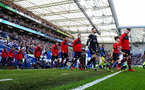 BRIGHTON, ENGLAND - MARCH 30: Southampton players walk out of the tunnel with the matchday mascot during the Premier League match between Brighton & Hove Albion and Southampton FC at American Express Community Stadium on March 30, 2019 in Brighton, United Kingdom. (Photo by Matt Watson/Southampton FC via Getty Images)
