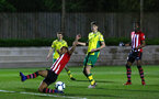 SOUTHAMPTON, ENGLAND - APRIL 05:  Near miss by Tyreke Johnson (left) during the U23's PL2 match between Southampton FC and Norwich City pictured at Staplewood Complex on April 05, 2019 in Southampton, England. (Photo by James Bridle - Southampton FC/Southampton FC via Getty Images)