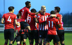 SOUTHAMPTON, ENGLAND - APRIL 05:  Tom O'Connor  scores and celebrates with Alfie Jones, Christoph Klarer, Aaron O'Driscoll, Kayne Ramsay, Jake Vokins, Nathan Tella  during the U23's PL2 match between Southampton FC and Norwich City pictured at Staplewood Complex on April 05, 2019 in Southampton, England. (Photo by James Bridle - Southampton FC/Southampton FC via Getty Images)