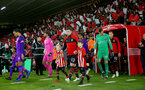 SOUTHAMPTON, ENGLAND - APRIL 05: Pierre-Emile Hojbjerg of Southampton leads the teams out with the match day mascots during the Premier League match between Southampton FC and Liverpool FC at St Mary's Stadium on April 6, 2019 in Southampton, United Kingdom. (Photo by Matt Watson/Southampton FC via Getty Images)