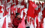 SOUTHAMPTON, ENGLAND - APRIL 05:   A fan takes his seat in the stadium in between flags placed on seats ahead of the Premier League match between Southampton FC and Liverpool FC at St Mary's Stadium on April 05, 2019 in Southampton, United Kingdom. (Photo by Southampton FC/Southampton FC via Getty Images)