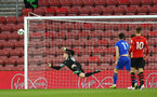 SOUTHAMPTON, ENGLAND - APRIL 10: Harry Lewis makes a save (left) during the International PL Cup match between Southampton FC and Dinamo Zagreb, pictured at St. Mary's Stadium on April 10, 2019 in Southampton, England. (Photo by James Bridle - Southampton FC/Southampton FC via Getty Images) (Photo by James Bridle - Southampton FC/Southampton FC via Getty Images)