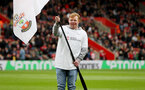 SOUTHAMPTON, ENGLAND - APRIL 13: Saints Foundation flag bearers during the Premier League match between Southampton FC and Wolverhampton Wanderers at St Mary's Stadium on April 13, 2019 in Southampton, United Kingdom. (Photo by Matt Watson/Southampton FC via Getty Images)