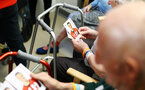 SOUTHAMPTON, ENGLAND - APRIL 17: Patients receive signed photos of players after they visit Southampton General Hospital pictured with patients and staff on April 17, 2019 in Southampton, England. (Photo by James Bridle - Southampton FC/Southampton FC via Getty Images)