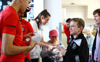 SOUTHAMPTON, ENGLAND - APRIL 17: A young Southampton fan (right) receives a signed photo from Jan Bednarek (left) during a visit to Southampton General Hospital pictured with patients and staff on April 17, 2019 in Southampton, England. (Photo by James Bridle - Southampton FC/Southampton FC via Getty Images)