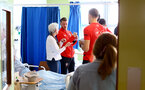 SOUTHAMPTON, ENGLAND - APRIL 17: Callum Slattery (middle) of Southampton FC visits Southampton General Hospital pictured with patients and staff on April 17, 2019 in Southampton, England. (Photo by James Bridle - Southampton FC/Southampton FC via Getty Images)