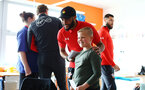 SOUTHAMPTON, ENGLAND - APRIL 17: Nathan Redmond (middle) of Southampton FC visits Southampton General Hospital pictured with patients and staff on April 17, 2019 in Southampton, England. (Photo by James Bridle - Southampton FC/Southampton FC via Getty Images)