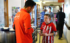 SOUTHAMPTON, ENGLAND - APRIL 17: Maya Yoshida (left) of Southampton FC visits Southampton General Hospital pictured with patients and staff on April 17, 2019 in Southampton, England. (Photo by James Bridle - Southampton FC/Southampton FC via Getty Images)