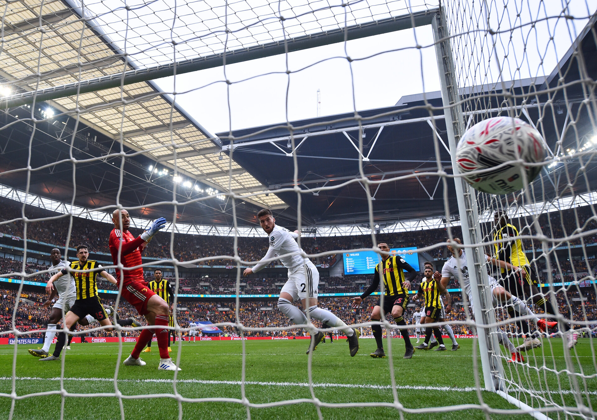 LONDON, ENGLAND - APRIL 07:  Matt Doherty of Wolverhampton Wanderers (2) scores his team's first goal past Heurelho Gomes of Watford during the FA Cup Semi Final match between Watford and Wolverhampton Wanderers at Wembley Stadium on April 07, 2019 in London, England. (Photo by Dan Mullan/Getty Images)