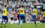 NEWCASTLE UPON TYNE, ENGLAND - APRIL 20: Danny Ings(L) and Mario Lemina(centre) of Southampton after scoring to make it 2-1 during the Premier League match between Newcastle United and Southampton FC at St. James Park on April 20, 2019 in Newcastle upon Tyne, United Kingdom. (Photo by Matt Watson/Southampton FC via Getty Images)