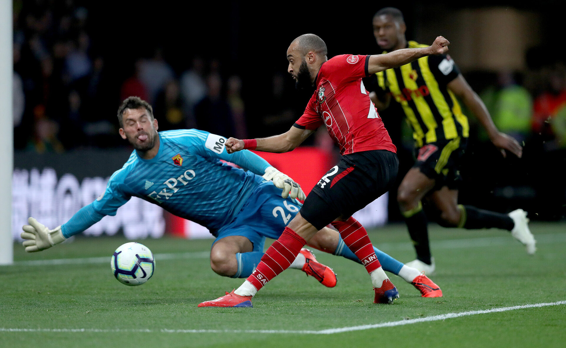 WATFORD, ENGLAND - APRIL 23: Nathan Redmond(R) of Southampton is denied by Ben Foster of Watfordduring the Premier League match between Watford FC and Southampton FC at Vicarage Road on April 23, 2019 in Watford, United Kingdom. (Photo by Matt Watson/Southampton FC via Getty Images)