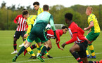 NORWICH, ENGLAND - APRIL 27: Christian Norton goes down after being tackle during a corner during a U18 Premier League match between Norwich City FC and Southampton FC pictured at Colney Training Ground on April 27, 2019 in Norwich, England. (Photo by James Bridle - Southampton FC/Southampton FC via Getty Images)