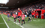 SOUTHAMPTON, ENGLAND - APRIL 27: Pierre-Emile Hojbjerg of Southampton leads the teams out with the match day mascots during the Premier League match between Southampton FC and AFC Bournemouth at St Mary's Stadium on April 27, 2019 in Southampton, United Kingdom. (Photo by Matt Watson/Southampton FC via Getty Images)